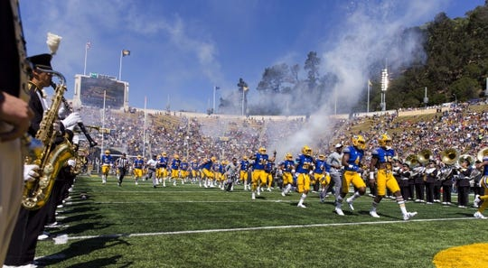 Sep 23, 2017; Berkeley, CA, USA;  The California Golden Bears run onto the filed before the game against the USC Trojans at Memorial Stadium. Mandatory Credit: John Hefti-USA TODAY Sports
