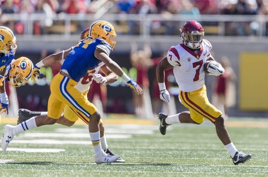 Sep 23, 2017; Berkeley, CA, USA; USC Trojans running back Stephen Carr (7) runs the ball against the California Golden Bears in the first quarter at Memorial Stadium. Mandatory Credit: John Hefti-USA TODAY Sports