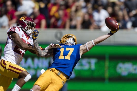 Sep 23, 2017; Berkeley, CA, USA; California Golden Bears wide receiver Vic Wharton III (17) reaches for a pass against the USC Trojans in the end zone but cannot make the reception in the first quarter at Memorial Stadium. Mandatory Credit: John Hefti-USA TODAY Sports