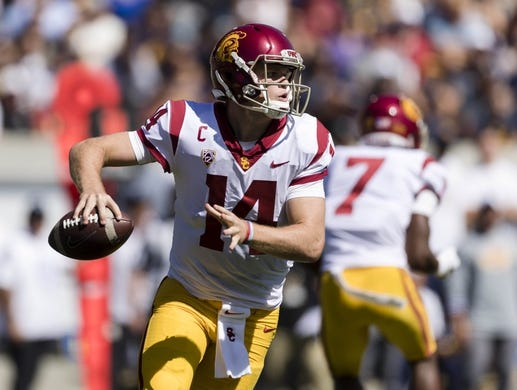 Sep 23, 2017; Berkeley, CA, USA; USC Trojans quarterback Sam Darnold (14) runs the ball against the California Golden Bears in the second quarter at Memorial Stadium. Mandatory Credit: John Hefti-USA TODAY Sports