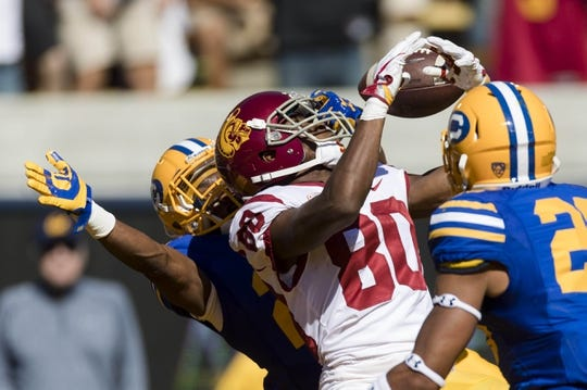 Sep 23, 2017; Berkeley, CA, USA; California Golden Bears cornerback Traveon Beck (22) breaks up a pass intended for USC Trojans wide receiver Deontay Burnett (80) in the fourth quarter at Memorial Stadium. Mandatory Credit: John Hefti-USA TODAY Sports