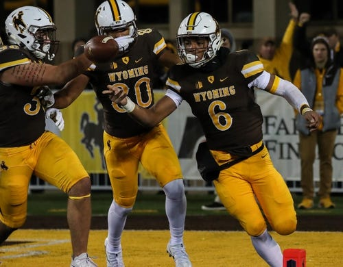 Sep 23, 2017; Laramie, WY, USA; Wyoming Cowboys running back Trey Woods (6) celebrates a touchdown against  the Hawaii Warriors during the second quarter at War Memorial Stadium. Mandatory Credit: Troy Babbitt-USA TODAY Sports