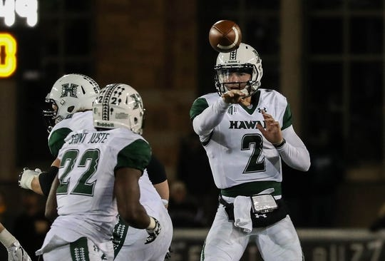Sep 23, 2017; Laramie, WY, USA; Hawaii Warriors quarterback Dru Brown (2) throws to running back Diocemy Saint Juste (22) against the Wyoming Cowboys during the second quarter at War Memorial Stadium. Mandatory Credit: Troy Babbitt-USA TODAY Sports