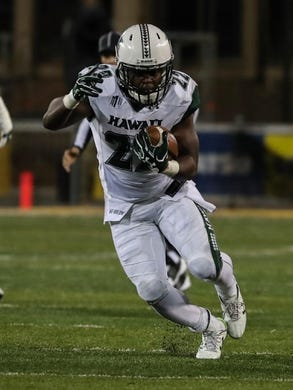 Sep 23, 2017; Laramie, WY, USA; Hawaii Warriors running back Diocemy Saint Juste (22) against the Wyoming Cowboys during the second quarter at War Memorial Stadium. Mandatory Credit: Troy Babbitt-USA TODAY Sports
