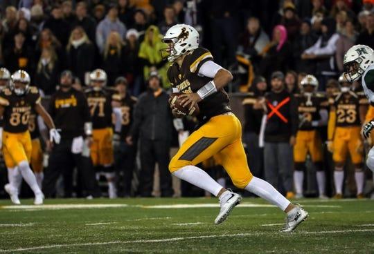 Sep 23, 2017; Laramie, WY, USA; Wyoming Cowboys quarterback Josh Allen (17) runs against the Hawaii Warriors  during the second quarter at War Memorial Stadium. Mandatory Credit: Troy Babbitt-USA TODAY Sports