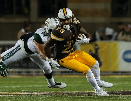 Sep 23, 2017; Laramie, WY, USA; Wyoming Cowboys wide receiver Austin Conway (25) runs against the Hawaii Warriors during the first quarter at War Memorial Stadium. Mandatory Credit: Troy Babbitt-USA TODAY Sports