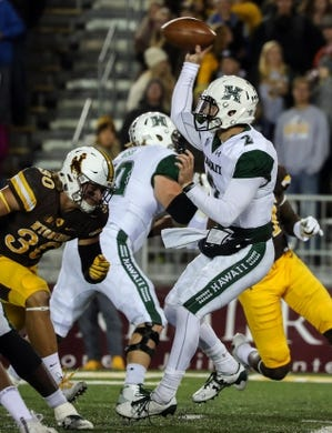 Sep 23, 2017; Laramie, WY, USA; Hawaii Warriors quarterback Dru Brown (2) throws against the Wyoming Cowboys during the second quarter at War Memorial Stadium. Mandatory Credit: Troy Babbitt-USA TODAY Sports