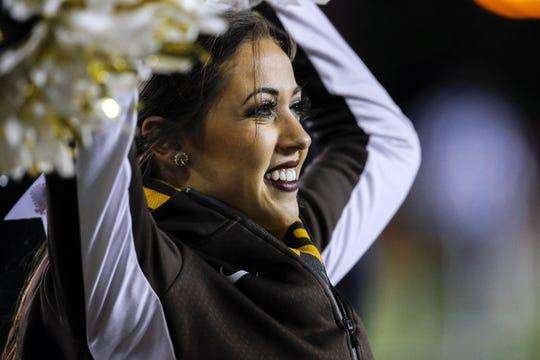Sep 23, 2017; Laramie, WY, USA; Wyoming Cowboys cheerleader Allie Telgenhoff performs during game against the Hawaii Warriors at War Memorial Stadium. Mandatory Credit: Troy Babbitt-USA TODAY Sports