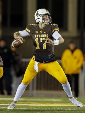 Sep 23, 2017; Laramie, WY, USA; Wyoming Cowboys quarterback Josh Allen (17) looks to throw against the Hawaii Warriors during the first quarter at War Memorial Stadium. Mandatory Credit: Troy Babbitt-USA TODAY Sports