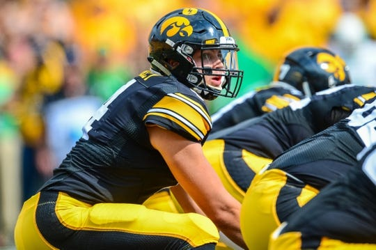 Sep 16, 2017; Iowa City, IA, USA; Iowa Hawkeyes quarterback Nathan Stanley (4) looks over center during the game against the North Texas Mean Green at Kinnick Stadium. Mandatory Credit: Jeffrey Becker-USA TODAY Sports
