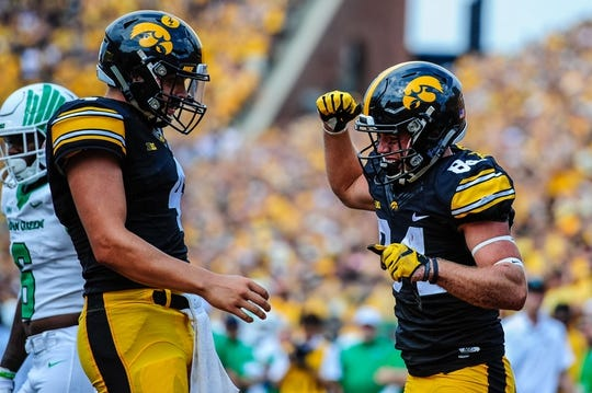 Sep 16, 2017; Iowa City, IA, USA; Iowa Hawkeyes wide receiver Nick Easley (right) celebrates with quarterback Nathan Stanley (4) during the game against the North Texas Mean Green at Kinnick Stadium. Mandatory Credit: Jeffrey Becker-USA TODAY Sports