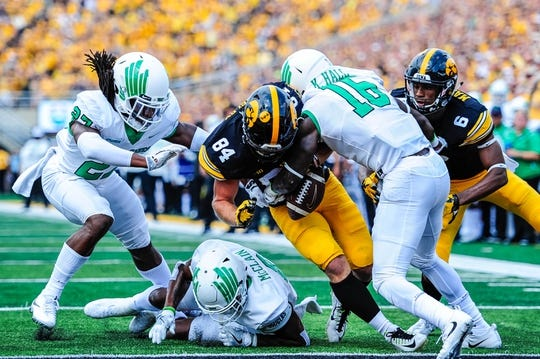 Sep 16, 2017; Iowa City, IA, USA; Iowa Hawkeyes wide receiver Nick Easley (84) fumbles near the end zone as he is hit by defensive back Kemon Hall (16) and defensive back Ashton Preston (27) and safety Kishawn McClain (6) during the game at Kinnick Stadium. Mandatory Credit: Jeffrey Becker-USA TODAY Sports