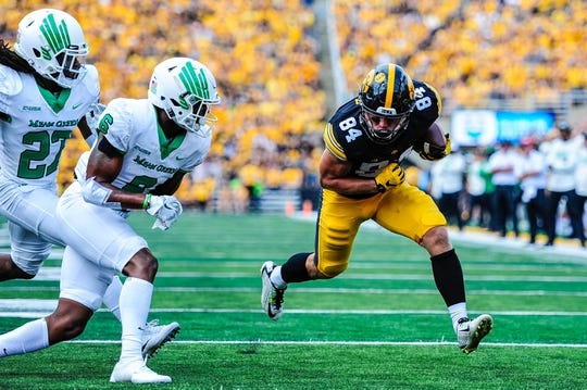 Sep 16, 2017; Iowa City, IA, USA; Iowa Hawkeyes wide receiver Nick Easley (84) heads towards the end zone as North Texas Mean Green defensive back Ashton Preston (27) and safety Kishawn McClain (6) close in for the tackle during the game at Kinnick Stadium. Mandatory Credit: Jeffrey Becker-USA TODAY Sports