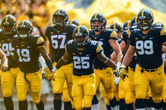 Sep 16, 2017; Iowa City, IA, USA; Iowa Hawkeyes running back Akrum Wadley (25) leads the team onto the field before the game against the North Texas Mean Green at Kinnick Stadium. Mandatory Credit: Jeffrey Becker-USA TODAY Sports