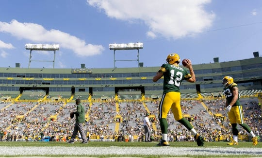 Sep 24, 2017; Green Bay, WI, USA; Green Bay Packers quarterback Aaron Rodgers (12) throws a pass during warmups prior to the game against the Cincinnati Bengals at Lambeau Field. Mandatory Credit: Jeff Hanisch-USA TODAY Sports