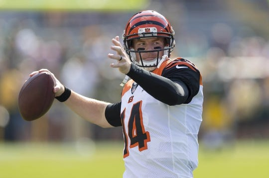 Sep 24, 2017; Green Bay, WI, USA; Cincinnati Bengals quarterback Andy Dalton (14) throws a pass during warmups prior to the game against the Green Bay Packers at Lambeau Field. Mandatory Credit: Jeff Hanisch-USA TODAY Sports