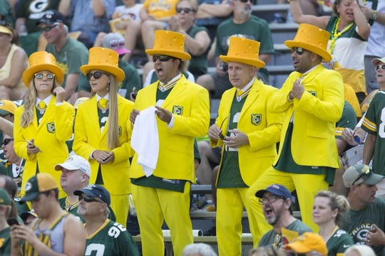 Sep 24, 2017; Green Bay, WI, USA; Green Bay Packers fans cheer during warmups prior to the game against the Cincinnati Bengals at Lambeau Field. Mandatory Credit: Jeff Hanisch-USA TODAY Sports