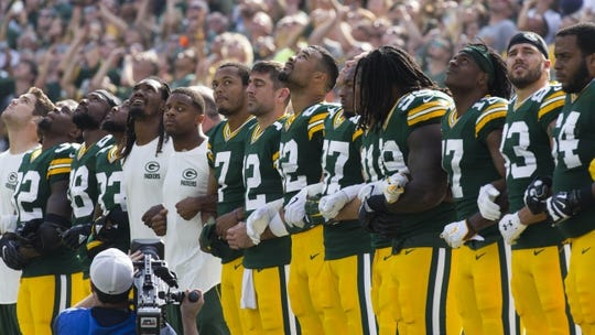 Sept 24, 2017; Green Bay, WS, USA; The Green Bay Packers stand for the National Anthem prior to the game against the Cincinnati Bengals. Mandatory Credit: Mark Hoffman/Milwaukee Journal Sentinel via USA TODAY Sports