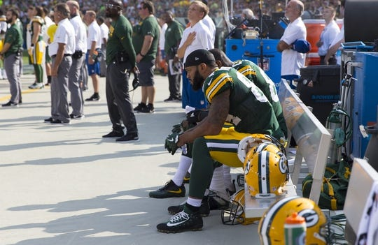 Sep 24, 2017; Green Bay, WI, USA; Green Bay Packers tight end Lance Kendricks (84) and tight end Martellus Bennett (80) sit on the bench during the national anthem prior to the game against the Cincinnati Bengals at Lambeau Field. Mandatory Credit: Jeff Hanisch-USA TODAY Sports