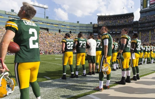 Sep 24, 2017; Green Bay, WI, USA; The Green Bay Packers lock arms during the national anthem prior to the game against the Cincinnati Bengals at Lambeau Field. Mandatory Credit: Jeff Hanisch-USA TODAY Sports