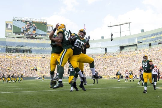 Sep 24, 2017; Green Bay, WI, USA; Green Bay Packers tight end Lance Kendricks (84) celebrates after catching  touchdown pass during the first quarter against the Cincinnati Bengals at Lambeau Field. Mandatory Credit: Jeff Hanisch-USA TODAY Sports