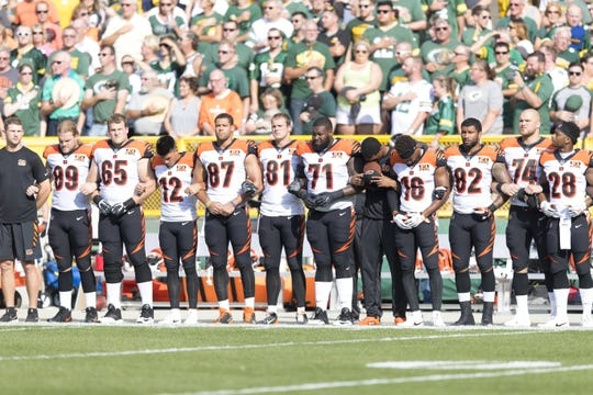 Sep 24, 2017; Green Bay, WI, USA; The Cincinnati Bengals lock arms during the national anthem prior to the game against the Green Bay Packers at Lambeau Field. Mandatory Credit: Jeff Hanisch-USA TODAY Sports