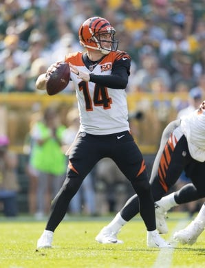 Sep 24, 2017; Green Bay, WI, USA; Cincinnati Bengals quarterback Andy Dalton (14) drops back to pass during the first quarter against the Green Bay Packers at Lambeau Field. Mandatory Credit: Jeff Hanisch-USA TODAY Sports