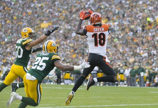 Sep 24, 2017; Green Bay, WI, USA; Cincinnati Bengals wide receiver A.J. Green (18) catches a touchdown pass during the first quarter against the Green Bay Packers at Lambeau Field. Mandatory Credit: Jeff Hanisch-USA TODAY Sports
