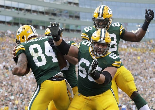 Sept 24, 2017; Green Bay, WS, USA; Green Bay Packers player Lance Kendricks (84) celebrates his touchdown with teammates offensive guard Lane Taylor (65) and running back Ty Montgomery (88) against the Cincinnati Bengals during the game at Lambeau Field. Mandatory Credit: Dan Powers/The Post-Crescent via USA TODAY Sports