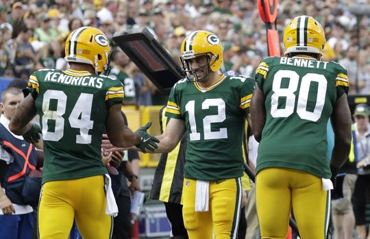 Sept 24, 2017; Green Bay, WS, USA; Green Bay Packers quarterback Aaron Rodgers (12) congratulates tight end Lance Kendricks (84) after he scored a touchdown against the Cincinnati Bengals during the game at Lambeau Field. Mandatory Credit: Dan Powers/The Post-Crescent via USA TODAY Sports