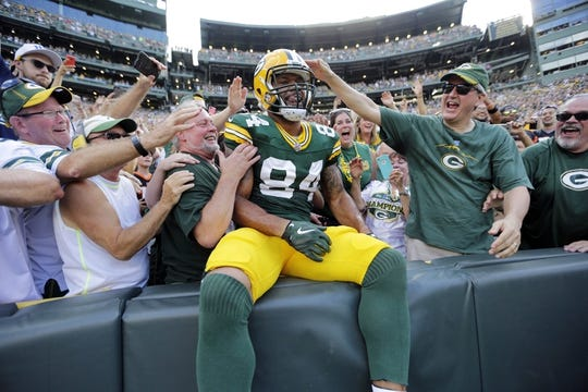 Sept 24, 2017; Green Bay, WS, USA; Green Bay Packers tight end Lance Kendricks (84) celebrates his touchdown with a Lambeau Leap against the Cincinnati Bengals during the game at Lambeau Field. Mandatory Credit: Dan Powers/The Post-Crescent via USA TODAY Sports