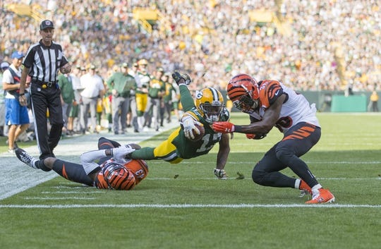 Sep 24, 2017; Green Bay, WI, USA; Green Bay Packers wide receiver Davante Adams (17) dives for the end zone before being tackled by Cincinnati Bengals safety Shawn Williams (36) during the first quarter at Lambeau Field. Mandatory Credit: Jeff Hanisch-USA TODAY Sports