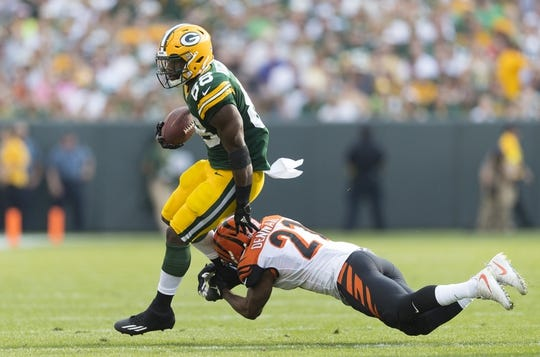 Sep 24, 2017; Green Bay, WI, USA; Cincinnati Bengals cornerback Darqueze Dennard (21) tries to tackle Green Bay Packers running back Ty Montgomery (88) during the second quarter at Lambeau Field. Mandatory Credit: Jeff Hanisch-USA TODAY Sports