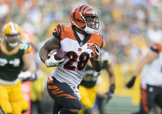 Sep 24, 2017; Green Bay, WI, USA; Cincinnati Bengals running back Joe Mixon (28) rushes with the football during the second quarter against the Green Bay Packers at Lambeau Field. Mandatory Credit: Jeff Hanisch-USA TODAY Sports