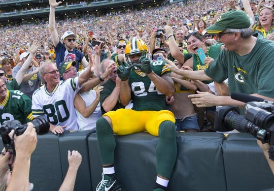 Sep 24, 2017; Green Bay, WI, USA; Green Bay Packers tight end Lance Kendricks (84) celebrates a touchdown after scoring during the first quarter against the Cincinnati Bengals at Lambeau Field. Mandatory Credit: Jeff Hanisch-USA TODAY Sports