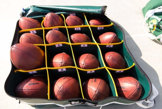 Sep 24, 2017; Green Bay, WI, USA; NFL Footballs sit on the Green Bay Packers sideline prior to the game against the Cincinnati Bengals at Lambeau Field. Mandatory Credit: Jeff Hanisch-USA TODAY Sports