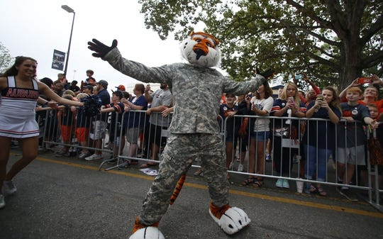 Oct 7, 2017; Auburn, AL, USA; Aubie, the Auburn Tigers mascot, leads the team through Tiger Walk prior to the game against the Ole Miss Rebels at Jordan-Hare Stadium. Mandatory Credit: John Reed-USA TODAY Sports