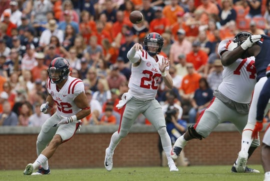 Oct 7, 2017; Auburn, AL, USA; Ole Miss Rebels quarterback Shea Patterson (20) throws a pass against the Auburn Tigers during the first quarter at Jordan-Hare Stadium. Mandatory Credit: John Reed-USA TODAY Sports