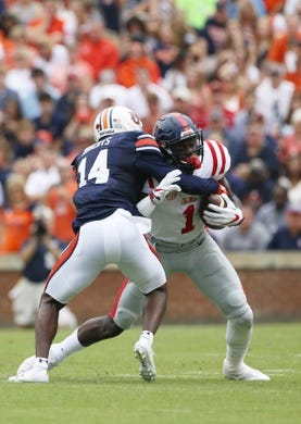 Oct 7, 2017; Auburn, AL, USA; Ole Miss Rebels receiver A.J. Brown (1) is tackled by Auburn Tigers defensive back Stephen Roberts (14) during the first quarter at Jordan-Hare Stadium. Mandatory Credit: John Reed-USA TODAY Sports