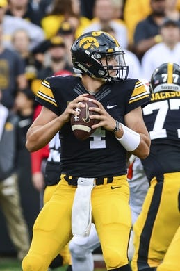 Oct 7, 2017; Iowa City, IA, USA; Iowa Hawkeyes quarterback Nathan Stanley (4) prepares to throw a pass against the Illinois Fighting Illini during the first quarter at Kinnick Stadium. Mandatory Credit: Jeffrey Becker-USA TODAY Sports