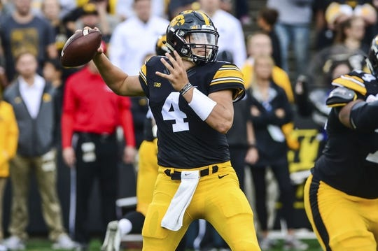 Oct 7, 2017; Iowa City, IA, USA; Iowa Hawkeyes quarterback Nathan Stanley (4) throws a pass against the Illinois Fighting Illini during the first quarter at Kinnick Stadium. Mandatory Credit: Jeffrey Becker-USA TODAY Sports