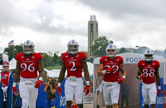 Oct 7, 2017; Lawrence, KS, USA; The Kansas Jayhawks take the field before the game against the Texas Tech Red Raiders in the first half at Memorial Stadium. Mandatory Credit: Jay Biggerstaff-USA TODAY Sports