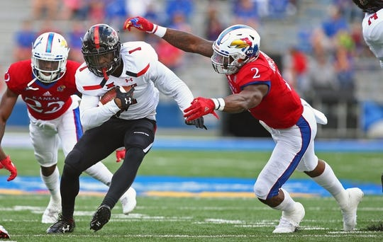 Oct 7, 2017; Lawrence, KS, USA; Texas Tech Red Raiders wide receiver Quan Shorts (1) runs against Kansas Jayhawks defensive end Dorance Armstrong Jr. (2) in the first half at Memorial Stadium. Mandatory Credit: Jay Biggerstaff-USA TODAY Sports