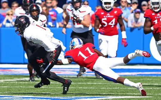 Oct 7, 2017; Lawrence, KS, USA; Texas Tech Red Raiders wide receiver Quan Shorts (1) runs against Kansas Jayhawks safety Mike Lee (11) in the first half at Memorial Stadium. Mandatory Credit: Jay Biggerstaff-USA TODAY Sports