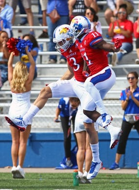 Oct 7, 2017; Lawrence, KS, USA; Kansas Jayhawks wide receivers Chase Harrell (3) and Steven Sims Jr. (11)  celebrate after scoring a touchdown against the Texas Tech Red Raiders in the first half at Memorial Stadium. Mandatory Credit: Jay Biggerstaff-USA TODAY Sports