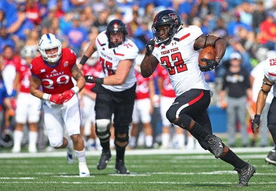 Oct 7, 2017; Lawrence, KS, USA; Texas Tech Red Raiders running back Desmond Nisby (32) runs for a touchdown against the Kansas Jayhawks in the first half at Memorial Stadium. Mandatory Credit: Jay Biggerstaff-USA TODAY Sports