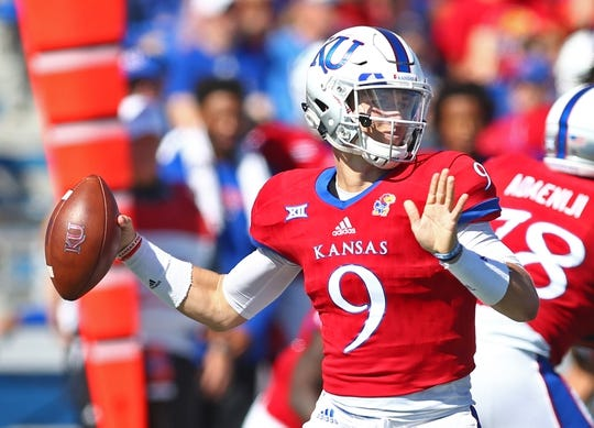 Oct 7, 2017; Lawrence, KS, USA; Kansas Jayhawks quarterback Carter Stanley (9) throws a pass against the Texas Tech Red Raiders in the first half at Memorial Stadium. Mandatory Credit: Jay Biggerstaff-USA TODAY Sports