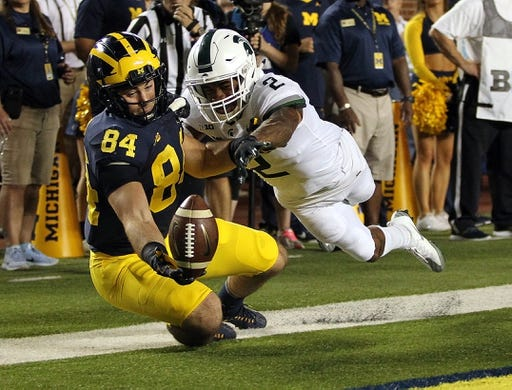 Oct 7, 2017; Ann Arbor, MI, USA; Michigan State Spartans cornerback Justin Layne (2) breaks up a pass intended for Michigan Wolverines tight end Sean McKeon (84) during the first quarter of a game at Michigan Stadium. Mandatory Credit: Mike Carter-USA TODAY Sports