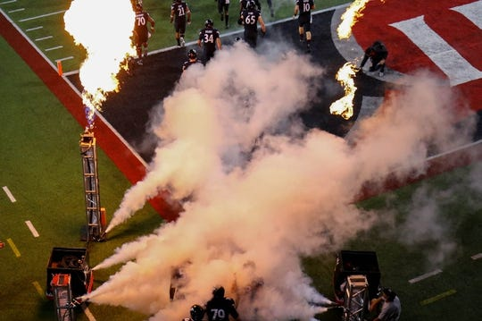 Oct 7, 2017; Cincinnati, OH, USA; The Cincinnati Bearcats take the field prior to the game against the UCF Knights at Nippert Stadium. Mandatory Credit: Aaron Doster-USA TODAY Sports