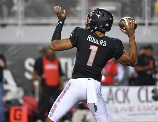 Oct 7, 2017; Las Vegas, NV, USA; UNLV Rebels quarterback Armani Rogers (1) looks to throw against the San Diego Aztecs at Sam Boyd Stadium. Mandatory Credit: Stephen R. Sylvanie-USA TODAY Sports